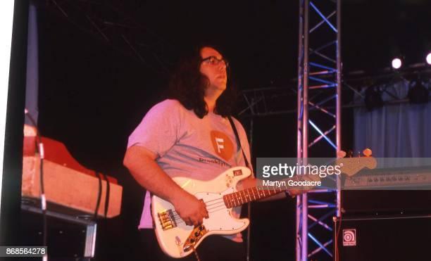 American musician James McNew of Yo La Tengo performs on stage at Glastonbury Festival 25th June 2000