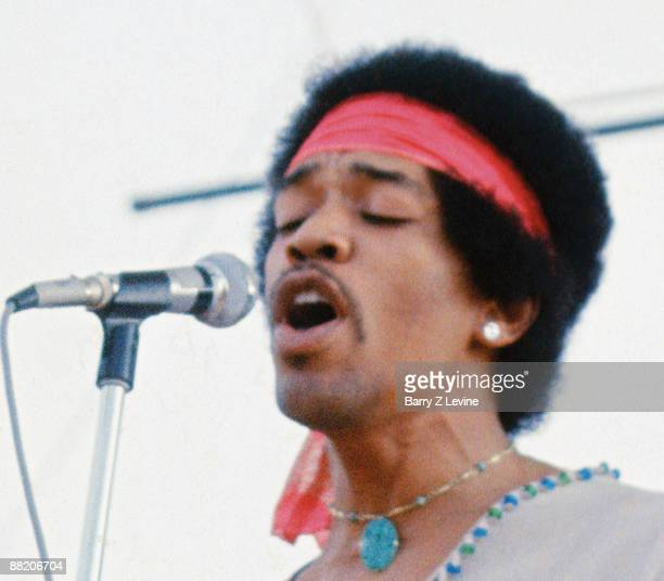 American musician Jimi Hendrix performs with his band, Gypsy Sun And Rainbows, onstage at the Woodstock Music and Arts Fair in Bethel, New York,...