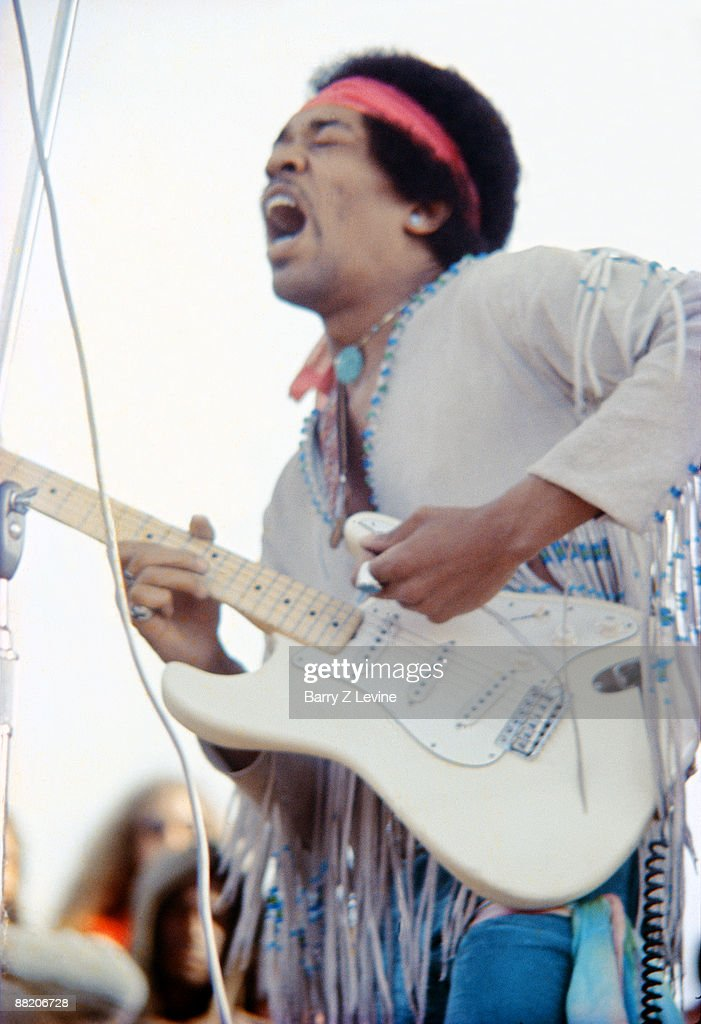 American musician Jimi Hendrix (1942 - 1970) performs with his band, Gypsy Sun And Rainbows, onstage at the Woodstock Music and Arts Fair in Bethel, New York, August 18, 1969.