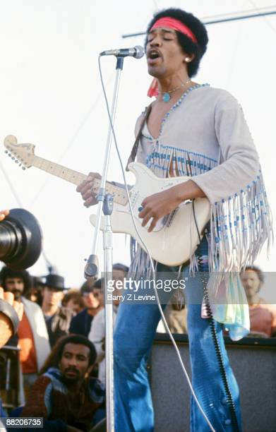 American musician Jimi Hendrix performs with his band Gypsy Sun And Rainbows onstage at the Woodstock Music and Arts Fair in Bethel New York August...