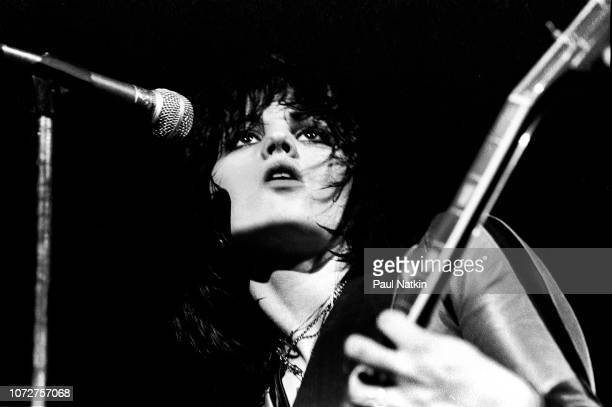 American musician Joan Jett , of the Runaways, plays guitar as she performs onstage at the Aragon Ballroom, Chicago, Illinois, March 25, 1977.