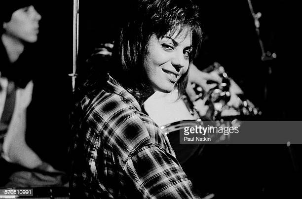 American musician Joan Jett performs onstage at the Thirsty Whale bar during filming of the movie 'Light of Day' , Chicago, Illinois, April 7, 1986.
