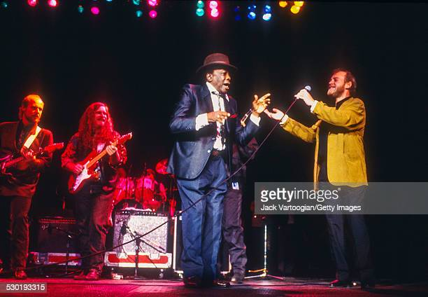 American musician John Lee Hooker and English Blues and Rock singer Joe Cocker backed by the Benson Hedges AllStar Blues Band perform during the...