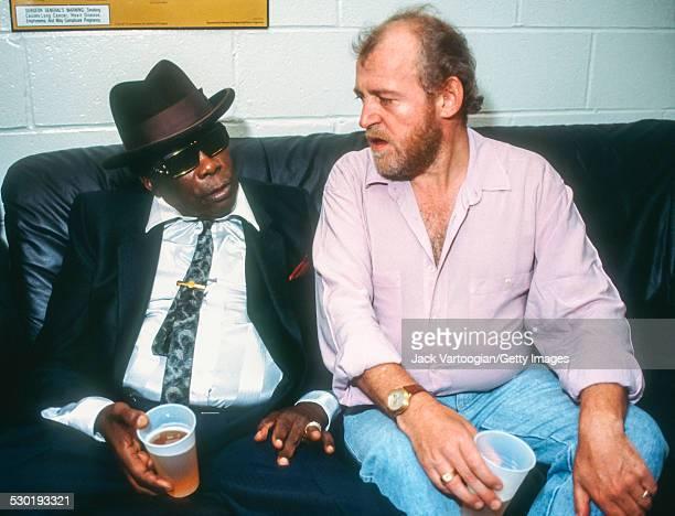 American musician John Lee Hooker and English Blues and Rock singer Joe Cocker chat backstage at the 'Benson Hedges Blues Salutes John Lee Hooker...