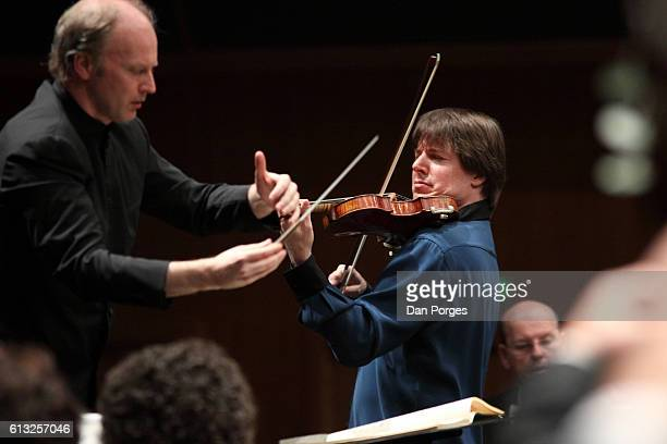 American musician Joshua Bell plays violin with the Israel Philharmonic Orchestra under Italian conductor Gianandrea Noseda during a performance at...