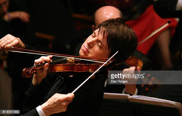 American musician Joshua Bell plays violin with the Israel Philharmonic Orchestra during a performance Jerusalem Israel November 11 2005