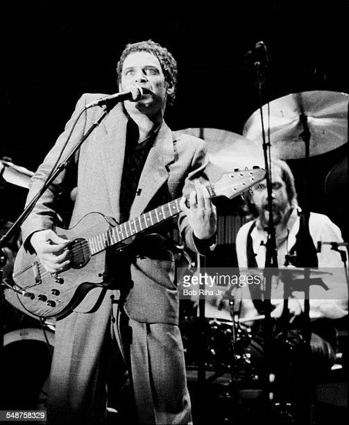 American musician Lindsey Buckingham and British musician Mick Fleetwood of the group Fleetwood Mac perform onstage at the Los Angeles Forum...
