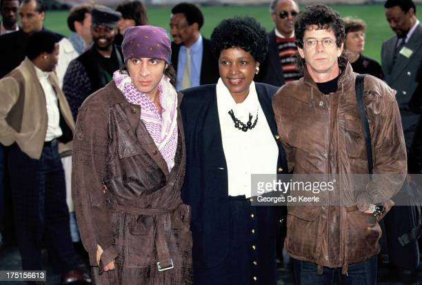 American musician Little Steven Winnie MadikizelaMandela and American musician Lou Reed attend backstage a concert held at Wembley Stadium to...