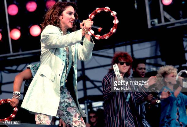 American musician Madonna performs onstage with the Thompson Twins during the Live Aid benefit concert at Veteran's Stadium Philadelphia Pennsylvania...