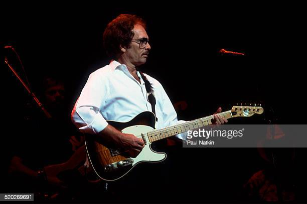 American musician Merle Haggard plays guitar as he performs onstage at the Poplar Creek Music Theater Hoffman Estates Illinois August 16 1983