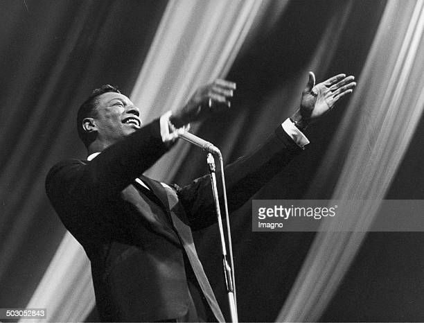 American musician Nat King Cole at a concert About 1960 Photograph by Franz Hubmann