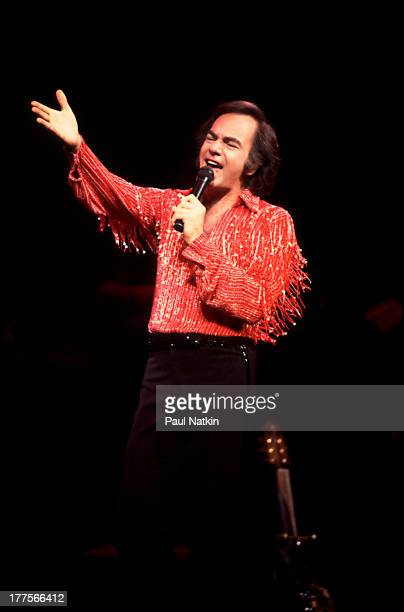 American musician Neil Diamond performs on stage at the Poplar Creek Music Theater Hoffman Estates Chicago Illinois August 23 1984