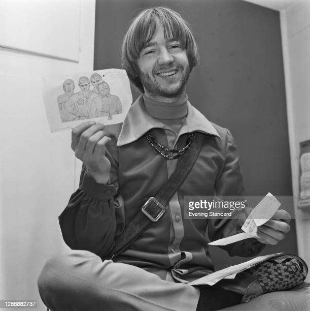 American musician Peter Tork of pop band the Monkees with a pile of sketches, UK, January 1968.
