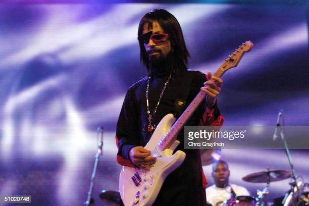 American musician Prince wears a wig sunglasses and a false goatee as a disguise with the opening act of The 10th Anniversary Essence Music Festival...