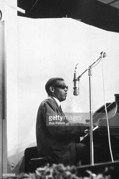 American musician Ray Charles sings and plays piano onstage at the Newport Jazz Festival Newport Rhode Island
