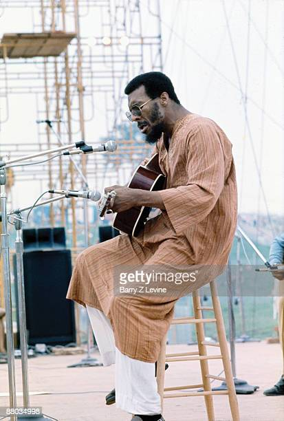 American musician Richie Havens performs onstage at the Woodstock Music and Arts Fair in Bethel New York August 15 1969