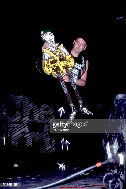 American musician Rick Nielsen plays a doublenecked guitar with the band Cheap Trick during a performance onstage Chicago Illinois June 15 1990