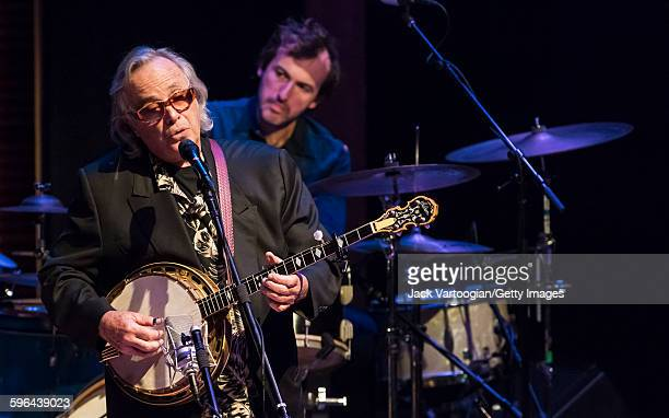 American musician Ry Cooder plays banjo with the CooderWhiteSkaggs band during a concert in the Carnegie Hall 'Perspectives Rosanne Cash' series at...