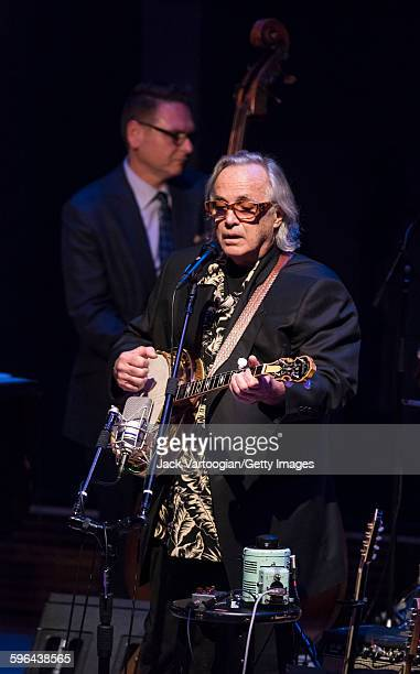 American musician Ry Cooder plays guitar with the CooderWhiteSkaggs band during a concert in the Carnegie Hall 'Perspectives Rosanne Cash' series at...