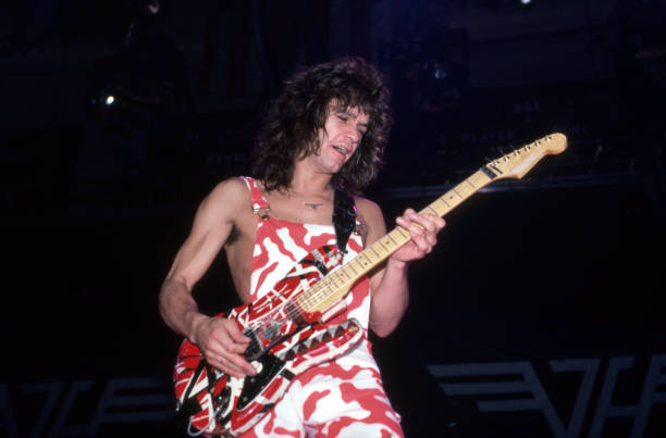 https://media.gettyimages.com/photos/american-musician-songwriter-producer-and-inventor-eddie-van-halen-picture-id1278848456?k=6&m=1278848456&s=612x612&w=0&h=X8C_Wvt8_x_cIsSiX-UKSGt6XRE4L6DAByK2S1yzGC0=