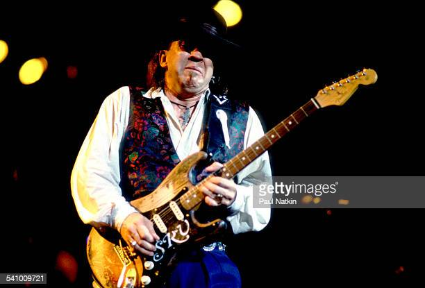 American musician Stevie Ray Vaughan plays guitar as he performs onstage at the Alpine Valley Music Theater, East Troy, Wisconsin, August 25, 1990.