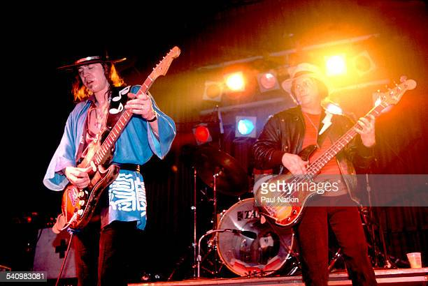American musician Stevie Ray Vaughan plays guitar with his band as they perform onstage at the Fireside Bowl Chicago Illinois February 17 1984