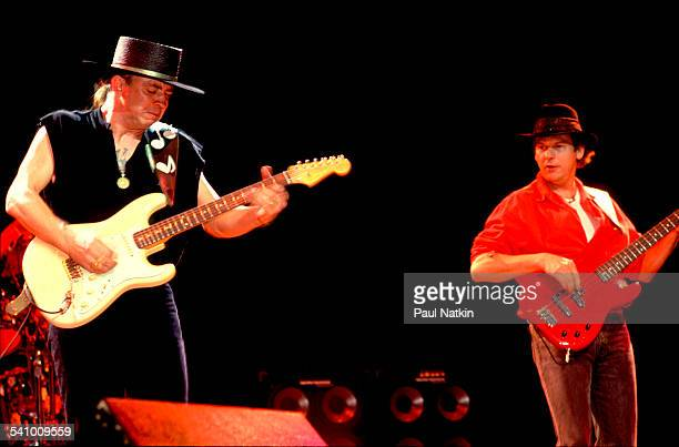 American musician Stevie Ray Vaughan plays guitar with his band as they perform at the Saratoga Performing Arts Center Saratoga New York September 1...