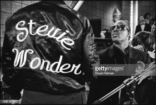 American musician Stevie Wonder speaks with a crewmember on the set of the television soap opera 'All My Children' New York New York 1986