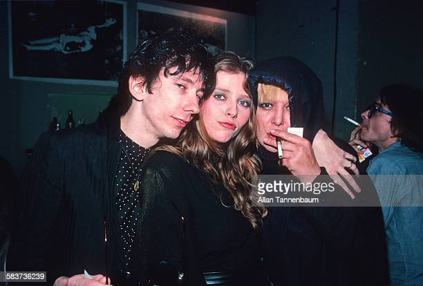 American musician Stiv Bators of the group the Dead Boys poses with his arm around models Bebe Buell and Anita Pallenberg at the Mudd Club New York...