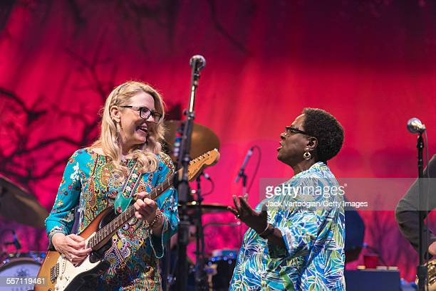 American musician Susan Tedeschi on guitar and guest vocalist Sharon Jones perform with the Tedeschi Trucks Band on opening night of the 30th...