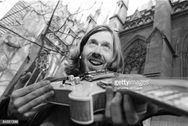 American musician Trey Anastasio of the band Phish poses for a portrait holding his guitar outside St Patrick's Cathedral in April 1994 in New York...