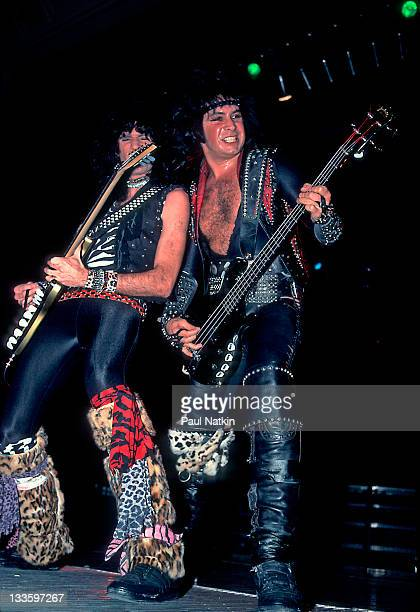 American musicians Bruce Kulick and Gene Simmons of the group Kiss perform at the Mecca Arena Milwaukee Wisconsin December 30 1984