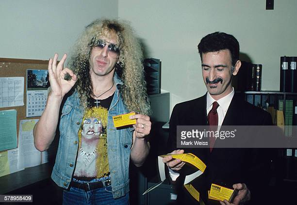American musicians Dee Snider and Frank Zappa hold up parental advisory stickers during the PMRC senate hearing at Capitol Hill Washington DC United...