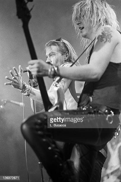 American musicians Duff McKagan and Axl Rose of the group Guns 'n' Roses perform in concert at the Ritz New York New York February 2 1988