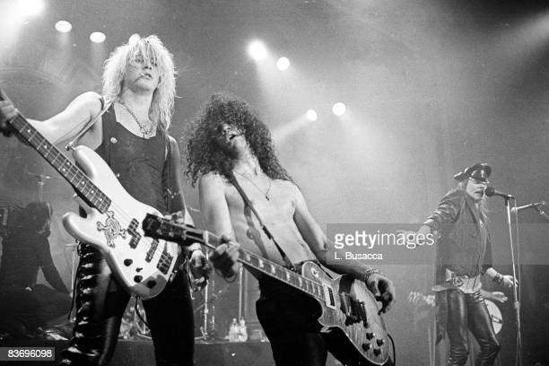American musicians Duff McKagan Slash and Axl Rose of the group Guns 'n' Roses perform in concert at the Ritz New York New York February 2 1988