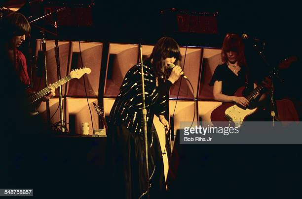 American musicians Howard Leese and sisters Ann and Nancy Wilson of the rock group Heart perform onstage at the Universal Amphitheatre Los Angeles...