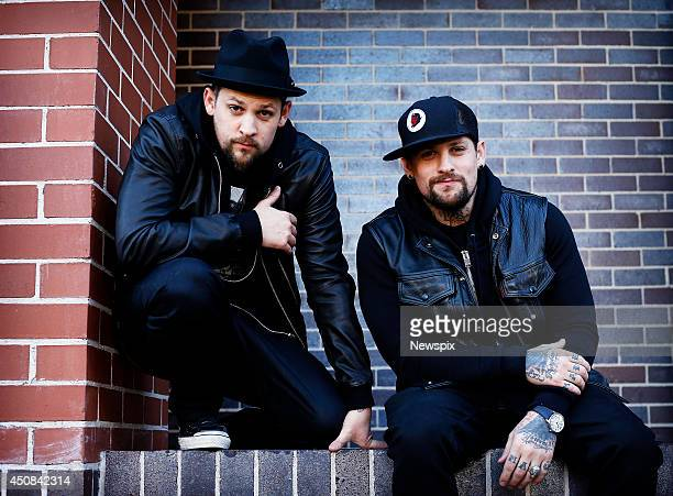 American musicians Joel Madden and Benji Madden of 'The Madden Brothers' pose during a photo shoot in Surry Hills on June 18 2014 in Sydney Australia