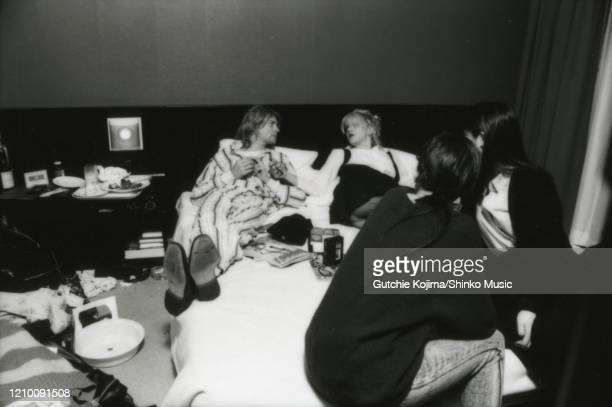 American musicians Kurt Cobain of Nirvana and Courtney Love of Hole lying in bed in Roppongi Prince Hotel in Tokyo, Japan, during an interview, 19th...