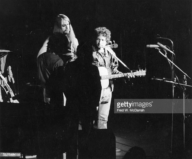 American musicians Leon Russell and Bob Dylan perform with unidentified others onstage during the Concert for Bangladesh benefit at Madison Square...