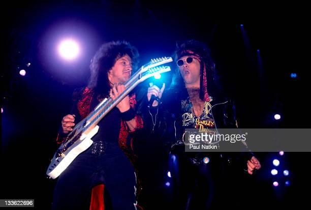 American musicians Richie Sambora and Alec John Such of the rock band Bon Jovi perform at Met Center on Bloomington Minnesota April 4 1989
