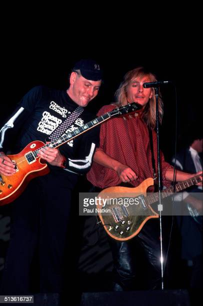 American musicians Rick Nielsen and Robin Zander of Cheap Trick perform onstage Chicago Illinois June 15 1990
