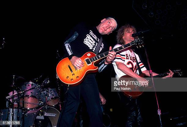 American musicians Rick Nielsen and Robin Zander of the band Cheap Trick perform at the Riviera Theater Chicago Illinois 1980s
