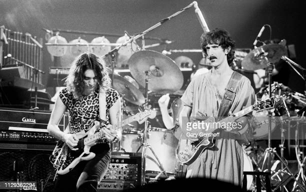 American musicians Steve Vai and Frank Zappa , both on guitar, perform on stage at the Palladium, New York, New York, October 31, 1981.