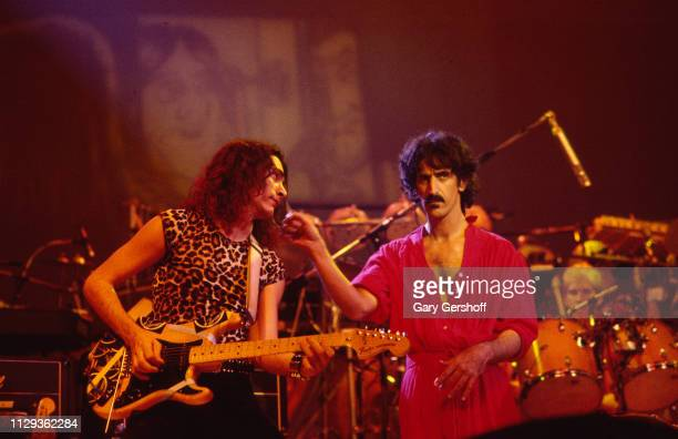 American musicians Steve Vai , on guitar, and Frank Zappa perform on stage at the Palladium, New York, New York, October 31, 1981.