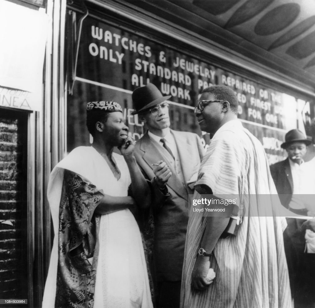 Malcolm X With Nigerians In Harlem : News Photo