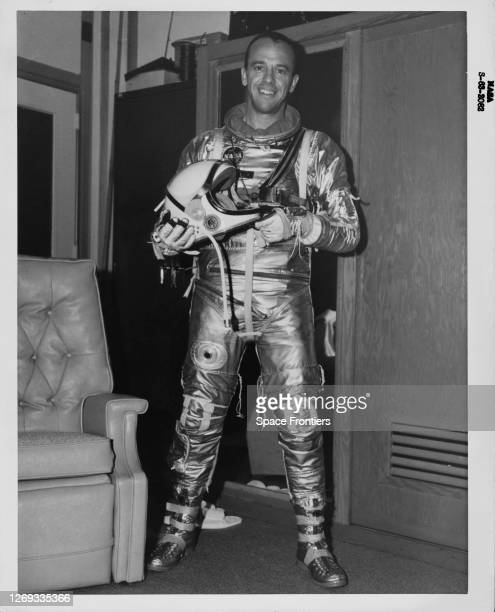 American NASA astronaut Alan B Shepard Jr wearing his Mercury pressure suit holding his helmet in his hands poses for a portrait prior to his launch...