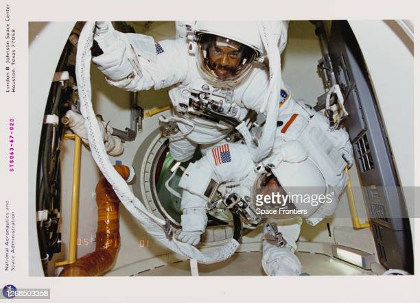 American NASA astronaut Bernard A Harris and BritishAmerican NASA astronaut Michael Foale prepare to leave the airlock for extravehicular activity...