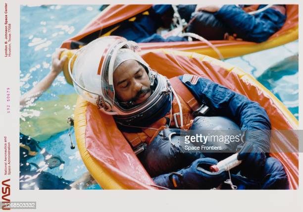 American NASA astronaut Bernard A Harris uses a small life raft as he participates in bailout training at the Weightless Environment and Training...