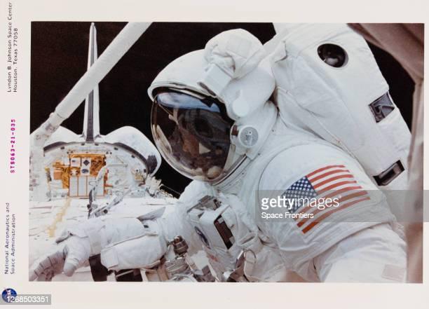 American NASA astronaut Bernard A Harris watches BritishAmerican NASA astronaut Michael Foale during the late phases of their shared extravehicular...