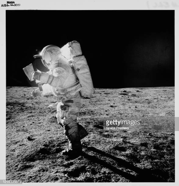 American NASA astronaut Edgar Mitchell studies a map as he walks across the lunar surface during extravehicular activity part of the Apollo 14...